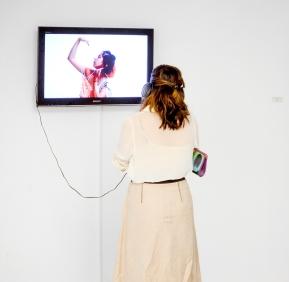 "Visitors enjoying Dana Aljouder's performance on video titles ""Enfilade"""