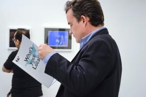 The Spanish Consul of Kuwait, Mr. Alberto Ucelay learning about the exhibition artworks by reading the artist statements