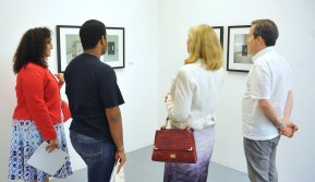 Steven Scott describing his artworks to Fatima Alsabah and Khalid Alsabah