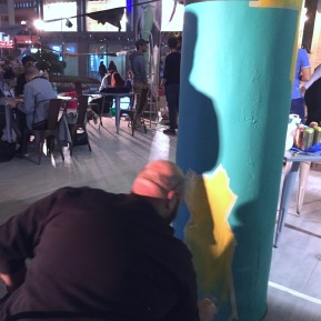 Ahmed Boudham spraying his street cats